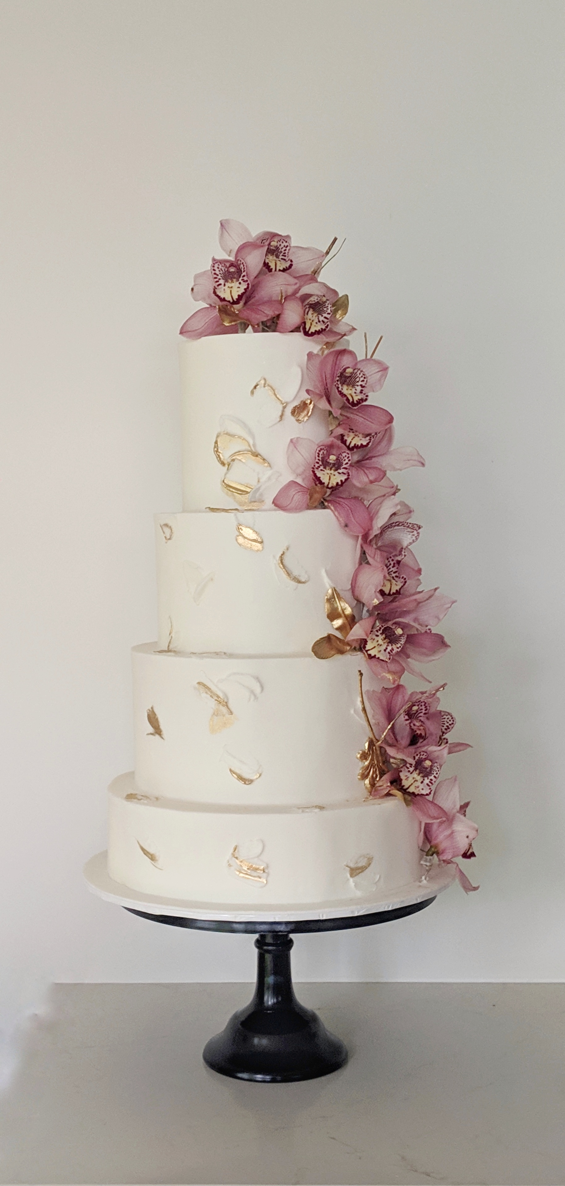 4 tier white fondant wedding cake with fresh flowers