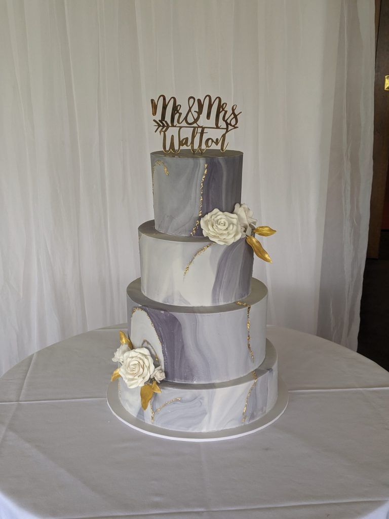 4 tier marble grey wedding cake with gold leaf and sugar flowers