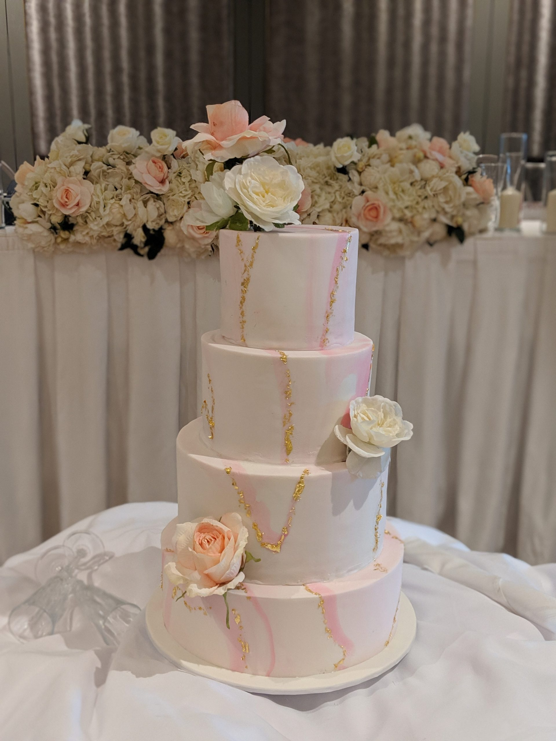 4 tier marble pink wedding cake with gold leaf and sugar flowers