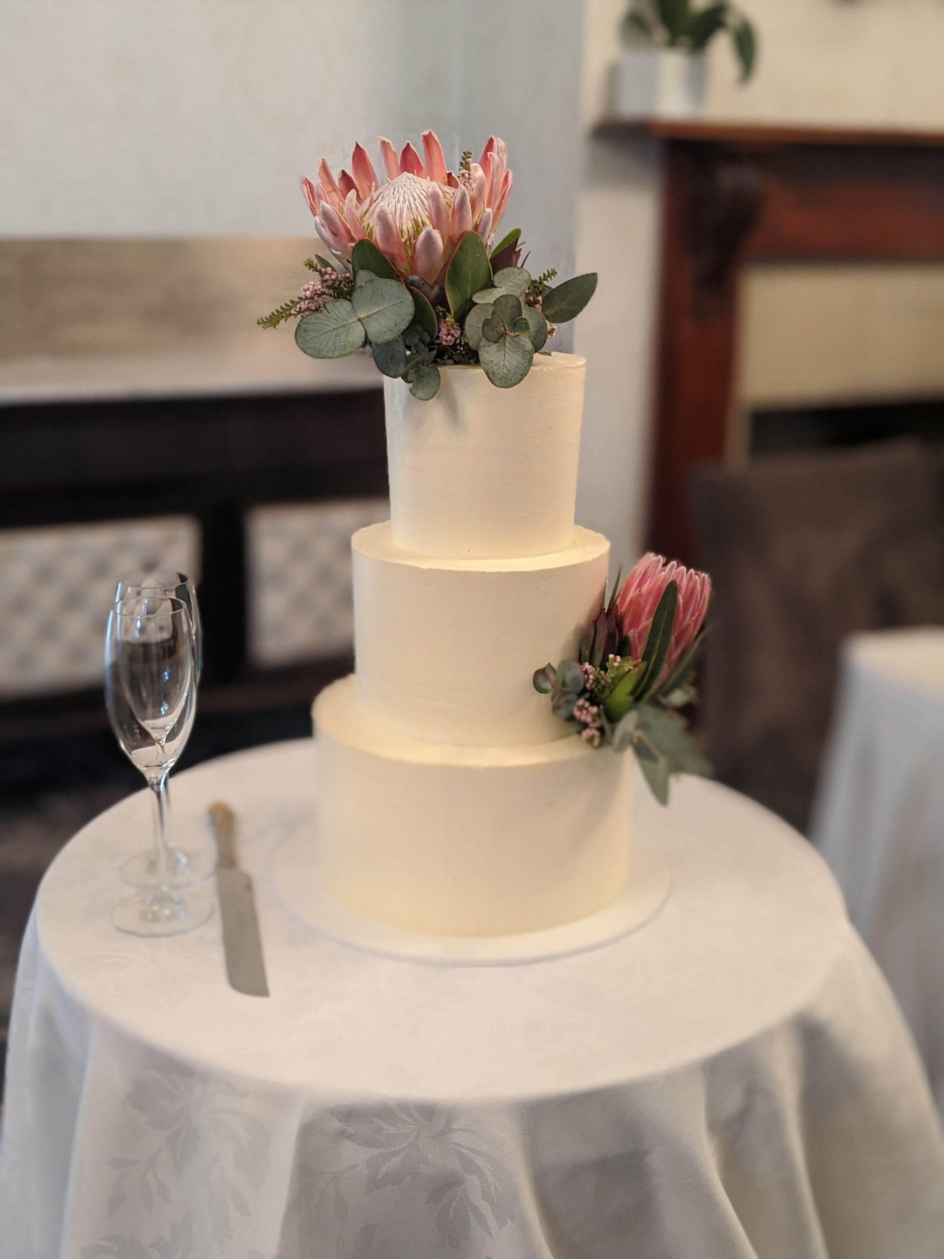 3 tiered buttercream wedding cake with native flowers