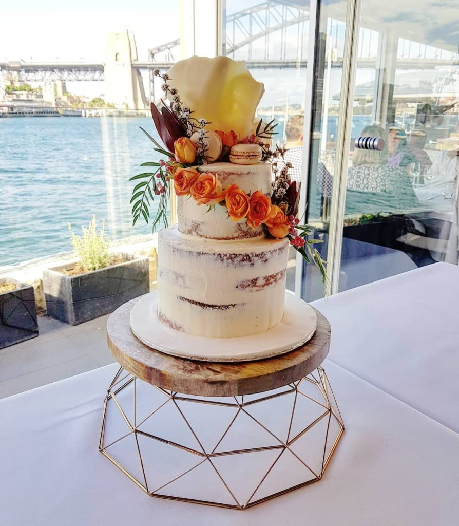 Semi-naked Buttercream Wedding Cake with Australian flowers
