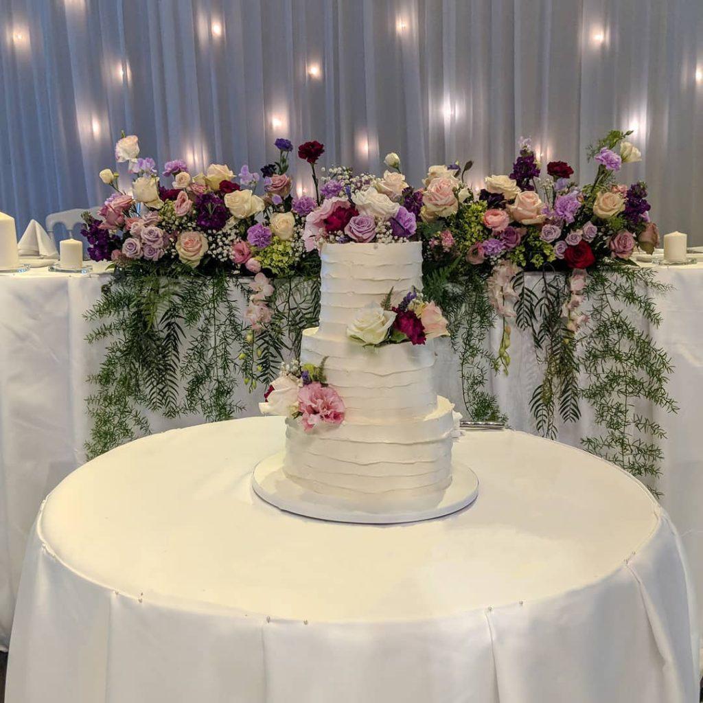 Romantic Textured Buttercream Wedding Cake with flowers