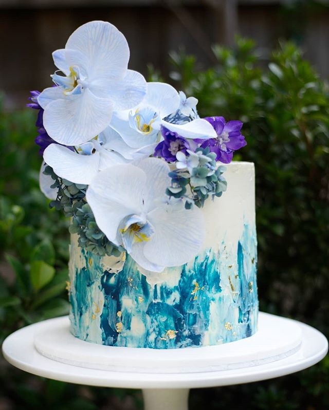 textured blue buttercream cake with fresh flowers sydney birthday cake