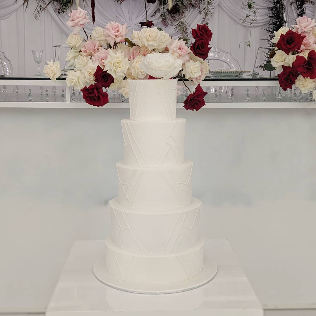 classic white fondant wedding cake with detailing