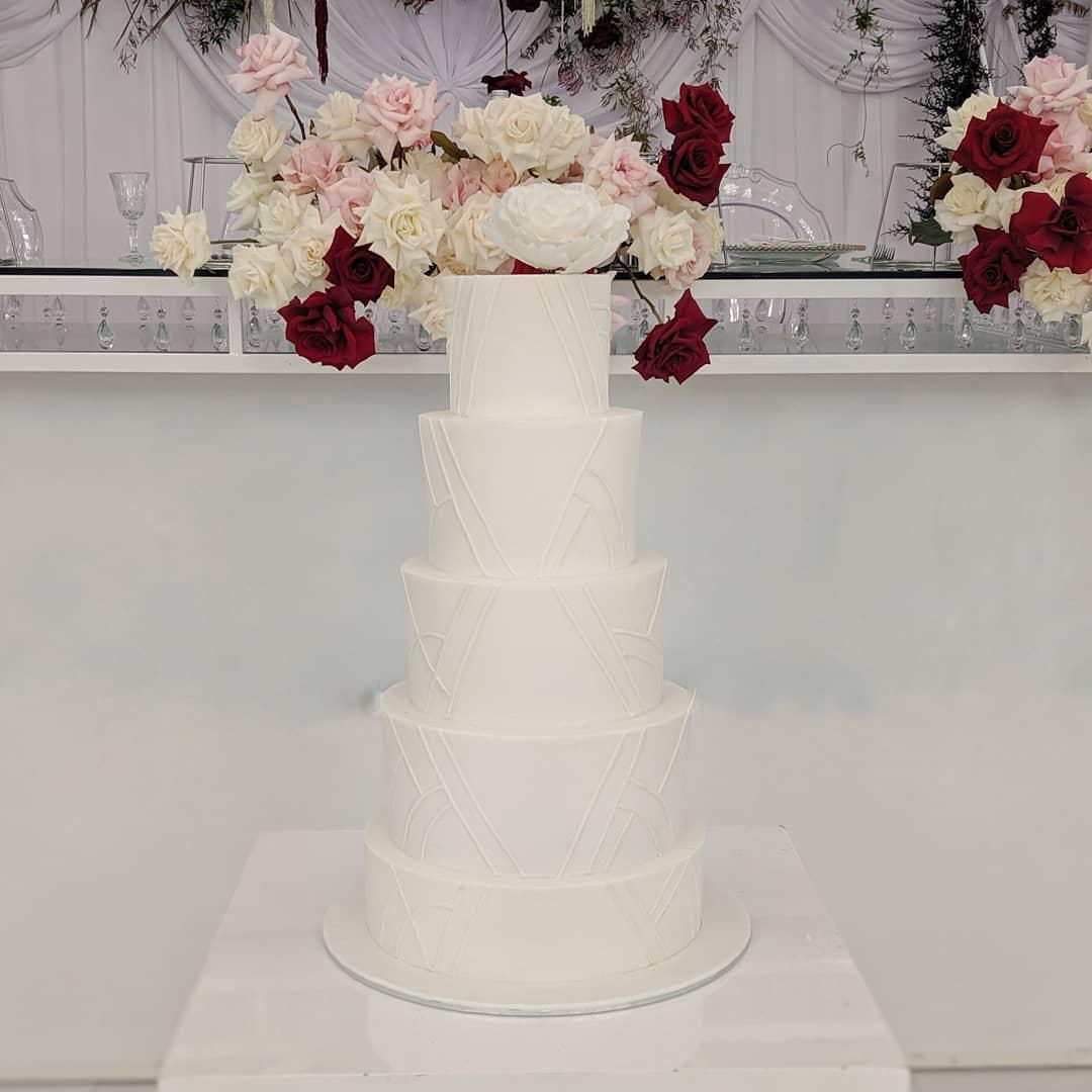 classic white fondant wedding cake with detailing
