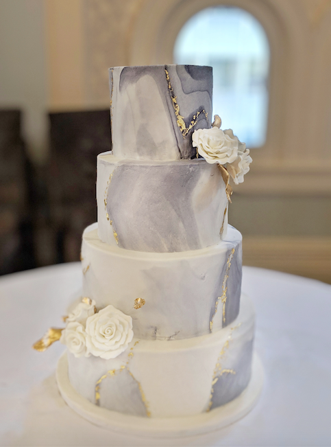fondant wedding cake with grey and white marbling and sugar flowers