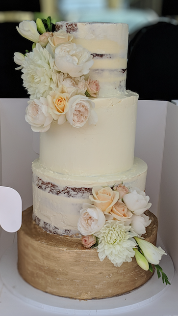 semi naked buttercream wedding cake in sydney with fresh roses + gold detailing