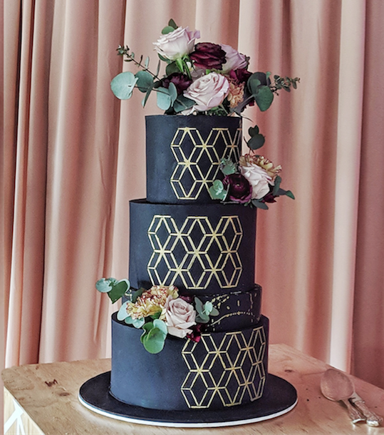 black fondant wedding cake with fresh flowers