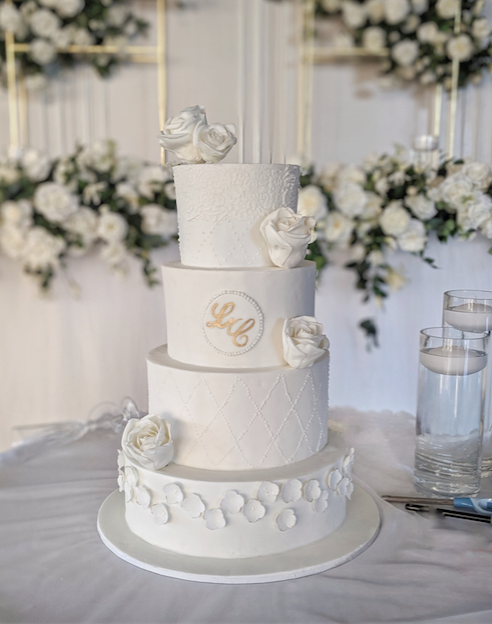 4 tier white fondant wedding cake