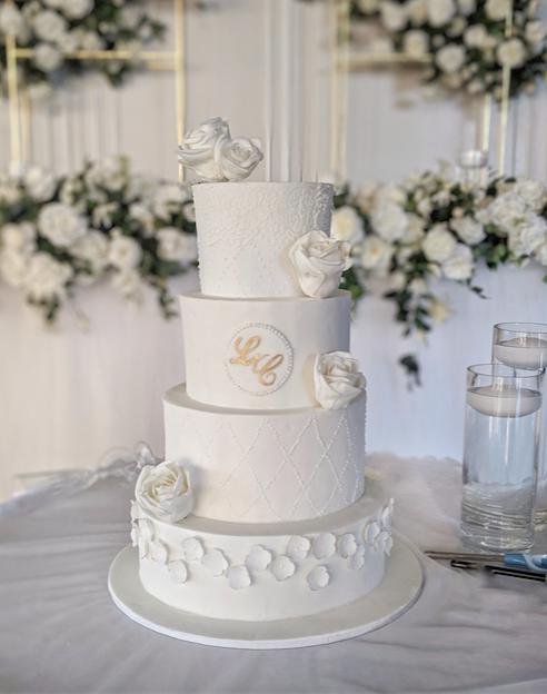 4 tier white fondant wedding cake