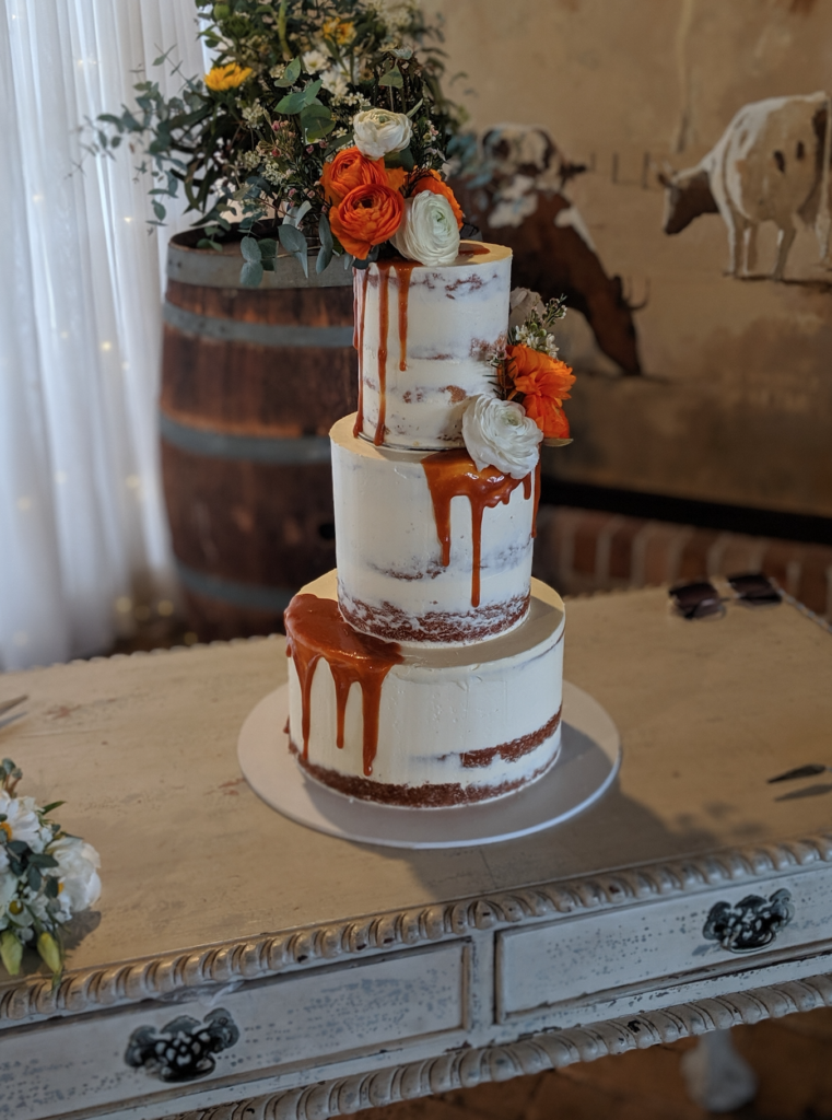 semi naked buttercream caramel drip wedding cake