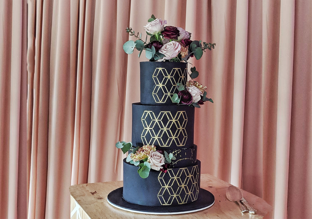 Statement Black Fondant Wedding Cake with flowers