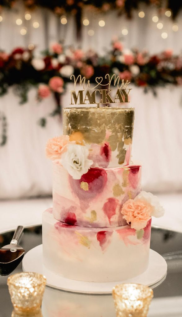 3 tier fondant colourful wedding cake with gold leaf