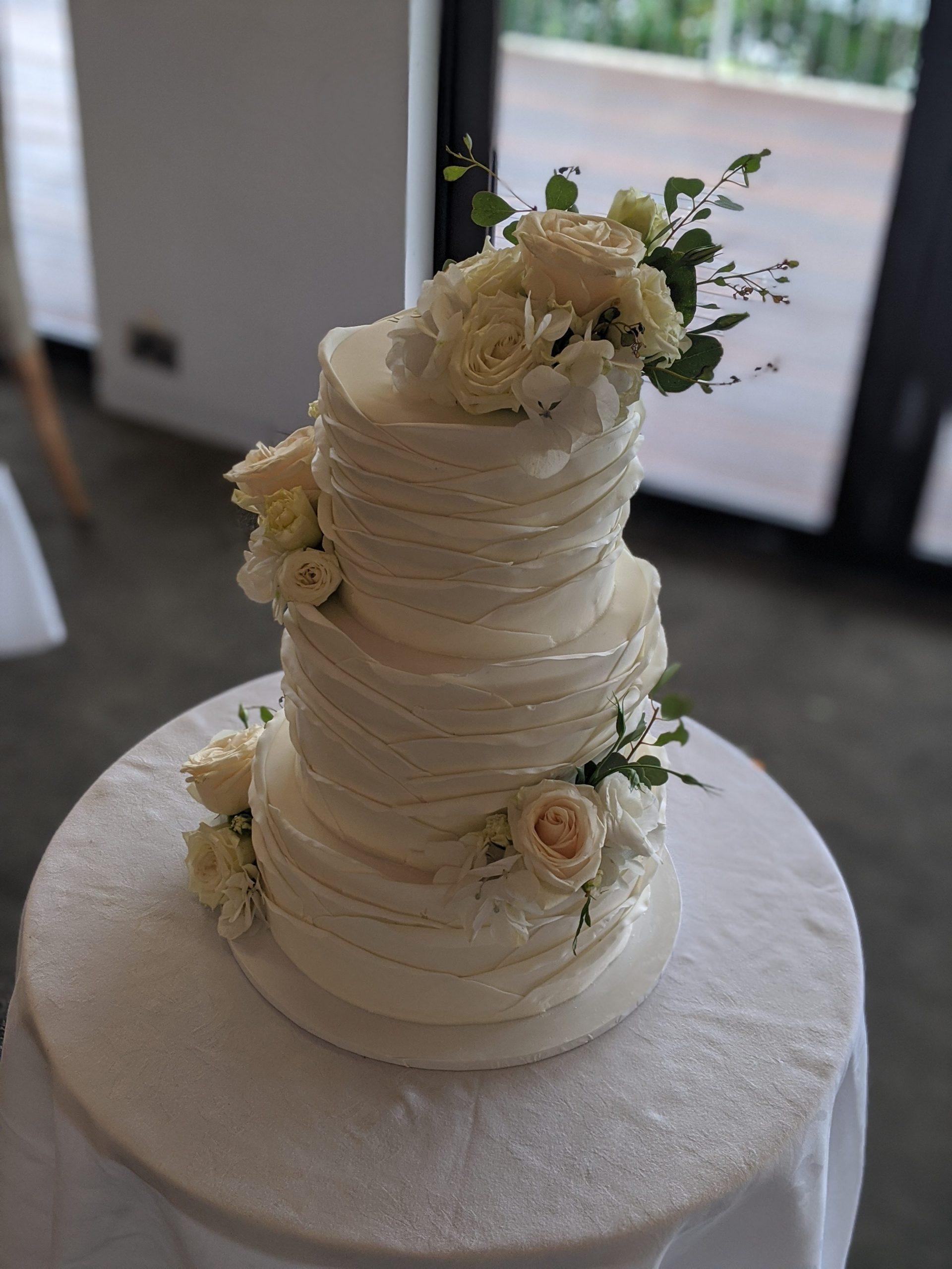3 tier fondant frill wedding cake with fresh florals. sydney wedding. fondant cake